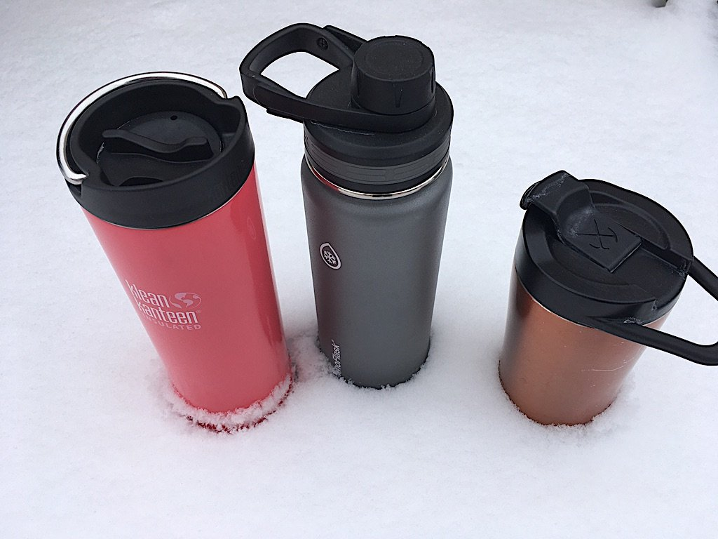 Insulated beverage thermoses in snow